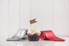 Fathers day concept. Delicious creative cupcake, tie, present. Stock Photo