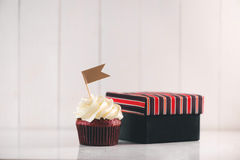 Fathers day concept. Delicious creative cupcake, tie on table. Royalty Free Stock Photos