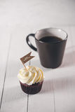 Fathers day concept. Delicious creative cupcake, tie on table. Stock Photos