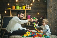 Fathers day concept. Father and baby son play with toys on fathers day. I have fathers day everyday. Happy fathers day. My dad is my best mate royalty free stock images