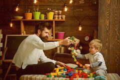 Fathers day concept. Father and baby son play with toys on fathers day. I have fathers day everyday. Happy fathers day royalty free stock image