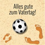 Fathers Day in Germany. On the beach a soccer ball, footprints of father and child. Fathers Day. Concept of holiday. On the beach a soccer ball, footprints of Royalty Free Stock Photo