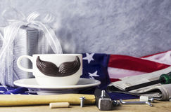 Fathers day concept of hot coffee with mustache and tool Stock Image