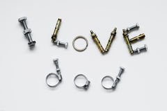Fathers day concept - I Love Dad texts. With bolts and nuts stock photography