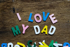 Fathers day concept - I Love My Dad texts. On Wooden Background Royalty Free Stock Photography