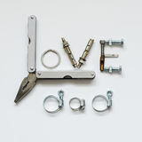 Fathers day concept - Love Dad texts with Long Nose Plier. Bolts and nuts Stock Image