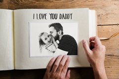 Fathers day concept. Photo album. Wooden background. royalty free stock photos