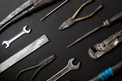 Fathers day concept. Vintage old tools on black paper background. Fathers day concept. Vintage old tools on black background royalty free stock image