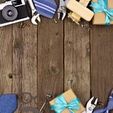 Fathers Day double border of gifts, ties and tools on rustic wood royalty free stock images
