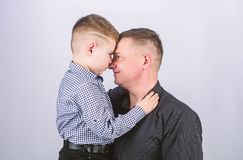 Fathers day. Father example of noble human. Family bonds. Family support. Real men. Trustful relations father and son. Father little son. Best friends. Dad and stock images