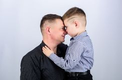 Fathers day. Father example of noble human. Family bonds. Family support. Real men. Trustful relations father and son. Father little son. Best friends. Dad and royalty free stock images