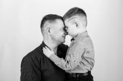 Fathers day. Father example of noble human. Family bonds. Family support. Real men. Trustful relations father and son stock image