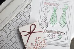 Fathers Day gift box and children`s coloring with ties royalty free stock images