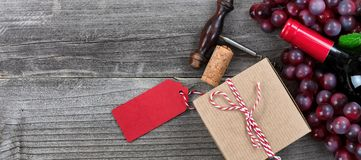 Fathers day gift box with a bottle of red wine and grapes for th Stock Images