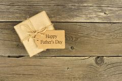 Fathers Day gift box with tag on rustic wood Stock Image