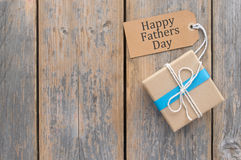 Fathers day gift. Over a wooden background with space Royalty Free Stock Photography