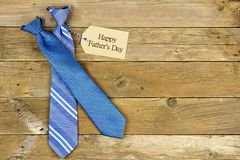 Fathers Day gift tag with ties on rustic wood. Happy Fathers Day gift tag with blue neckties on rustic wood background Stock Photos
