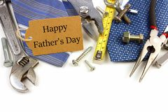 Fathers Day gift tag with tools and ties. Happy Fathers Day gift tag with border of tools and ties on a white background Stock Photo