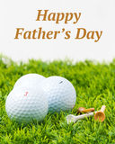 Fathers Day Golf Balls. Three white golf balls and tees with a Fathers Day inscription Stock Images