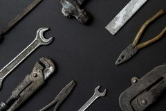 Fathers day greeting card concept. Vintage old tools on black paper background. Flat lay. Copy space.  royalty free stock image