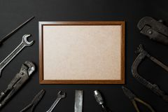 Fathers day greeting card concept. Vintage old tools on black paper background. Flat lay. Copy space royalty free stock photos
