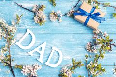 Fathers Day message with apple blossoms and gift box on blue woo Royalty Free Stock Photos