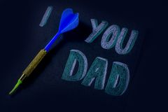 Fathers day message on a black background. I love you dad message written by pencil on black background Stock Images