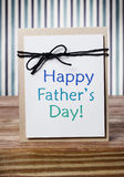 Fathers day message card. On wooden board over blue striped background royalty free stock image