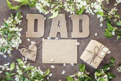Fathers Day message from cardboard letters, blank card and a gif Stock Photography
