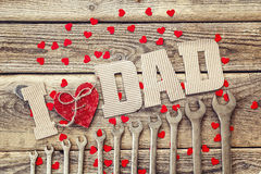 Fathers Day message from cardboard letters, spanners and red hearts. Happy fathers day concept. royalty free stock photos