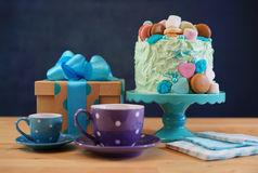 Fathers Day party table with cake and gifts. Stock Photography
