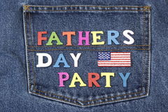 Fathers Day Party Wood Sign On Blue Jeans Back Pocket Stock Images