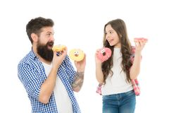 Fathers day present. Perfect for dads with sweet tooth. Girl child and dad hold colorful glazed donuts. Sweets and. Treats concept. Daughter and father eat royalty free stock photos