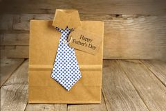 Fathers Day shirt and tie gift bag with wood background Royalty Free Stock Photos
