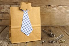 Fathers Day shirt and tie gift bag on wood Royalty Free Stock Photo