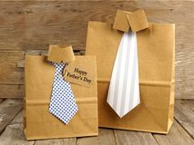Fathers Day shirt and tie gift bags on a wood stock photography