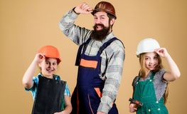 Fathers day. Sisters help father builder. Home renovation. Create room you really want live. Follow father. Dream team. Father builder and kids girls repair stock images