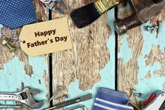 Fathers Day tag and double border of tools on wood Royalty Free Stock Images