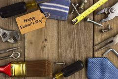 Fathers Day tag with tools and ties frame on wood Stock Image
