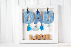 Fathers Day theme with hanging  DAD letters Royalty Free Stock Photography