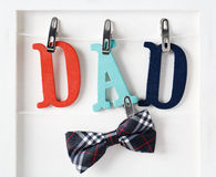 Fathers Day theme with hanging  DAD letters Royalty Free Stock Images