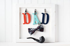 Fathers Day theme with hanging  DAD letters Stock Photos