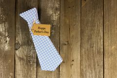 Fathers Day tie shaped gift box with tag on wood Royalty Free Stock Photography