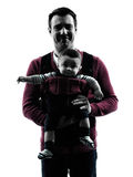 Fathers parents with baby carrier  portrait silhouette Royalty Free Stock Images