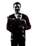 Fathers parents with baby carrier  portrait silhouette Royalty Free Stock Image