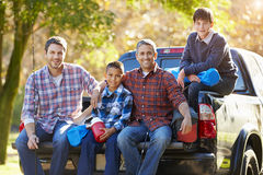 Fathers With Sons Sitting In Truck On Camping Holiday. Smiling At Camera Stock Image