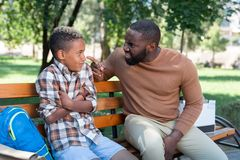 Cheerless unhappy man having a talk with his son. Fathers talk. Cheerless unhappy men having a talk with his son while trying to teach him on how to behave stock photography