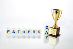 Fathersday spelled out with a trophy cup Stock Images
