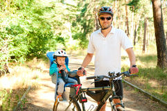 Fathr and little son on bike Royalty Free Stock Image
