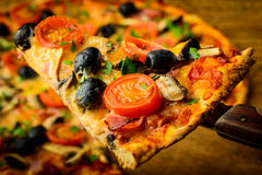 Fatia da pizza Foto de Stock Royalty Free
